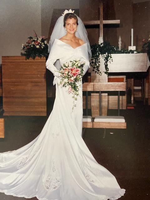 Bride in white wedding dress with a bouquet